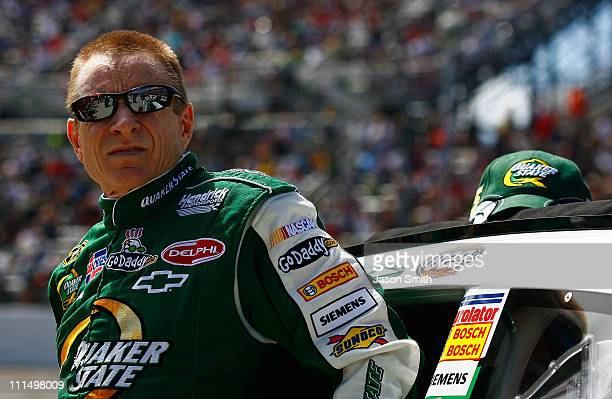 Mark Martin driver of the Quaker State/GoDaddycom Chevrolet stands next to his car on the grid prior to the NASCAR Sprint Cup Series Goody's Fast...