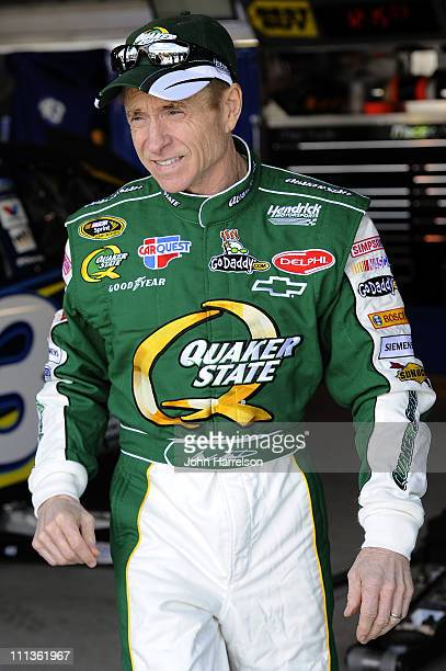 Mark Martin driver of the Quaker State/GoDaddycom Chevrolet walks in the garage area during practice for the NASCAR Sprint Cup Series Goody's Fast...