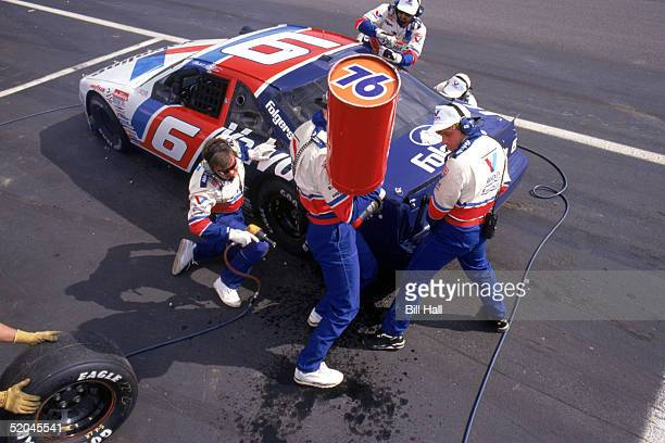 Mark Martin driver of the Roush Racing Valvoline Team makes a pit stop as he competes in the 1993 Coca Cola 600 at Charlotte Motor Speedway in...
