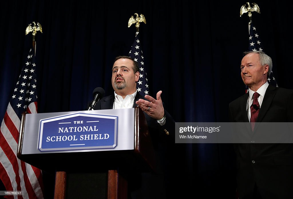 Mark Mattioli (L), the father of a victim of the Sandy Hook Elementary shooting, voices his support for recommendations announced by former U.S. Rep. Asa Hutchinson (R) and the NRA backed National School Shield Program regarding school security during a press conference April 2, 2013 at the National Press Club in Washington, DC. Among other findings, the report recommended training and placing armed personnel in public schools following the Sandy Hook Elementary School shooting.