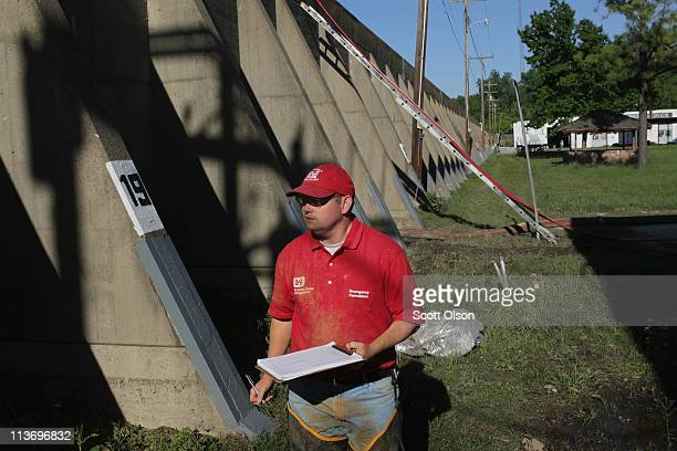 Mark Mazzone of the Army Corps of Engineers inspects seepage from the Mississippi River coming through the Hickman Flood Wall May 4 2011 in Hickman...