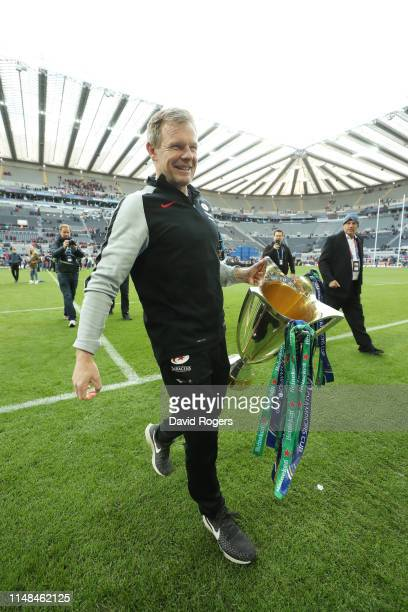 Mark McCall, Director of Rugby of Saracens lifts the Champions Cup trophy following the Champions Cup Final match between Saracens and Leinster at...