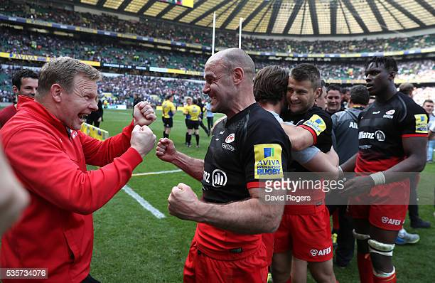 Mark McCall the Saracens director of rugby celebrates with Charlie Hodgson during the Aviva Premiership final match between Saracens and Exeter...