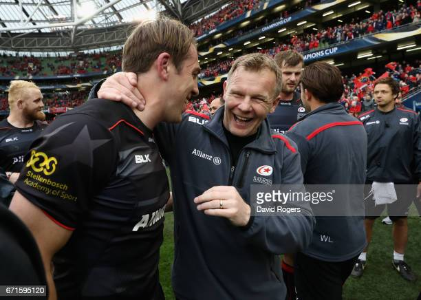 Mark McCall the Saracens director of rugby celebrates with second try scorer Chris Wyles after their victory during the European Rugby Champions Cup...