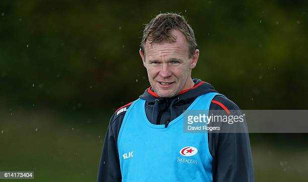 Mark McCall, the Saracens director of rugby, looks on during the Saracens training session held at their training venue on October 12, 2016 in St...