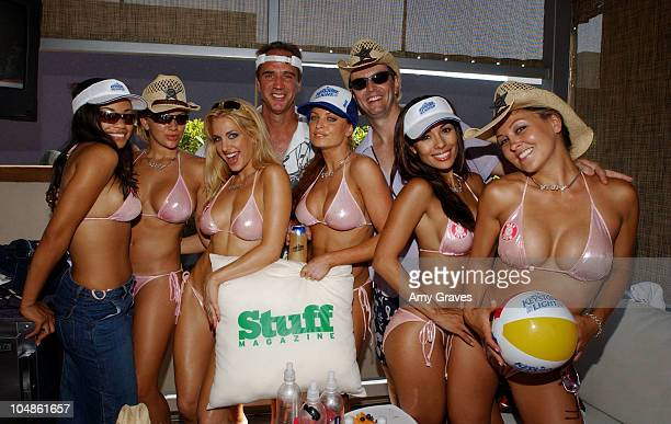 Mark McDonald General Manager of Stuff Magazine and Tom McLoughlin Marketing Director of Keystone Light with The Man Show Juggie Girls