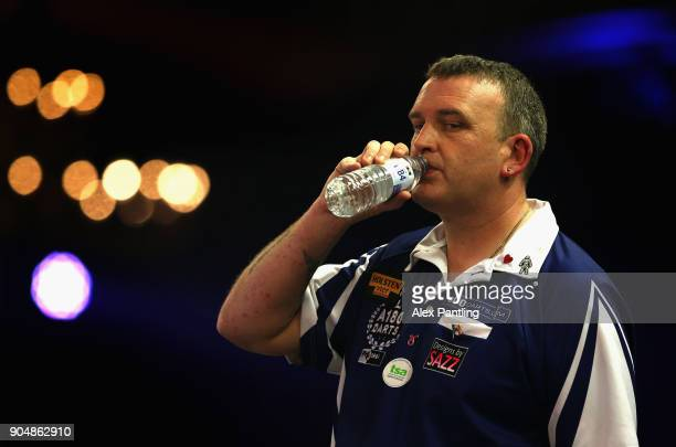 Mark McGeeney of England drinks from a bottle of water during the final of the BDO World Darts Championship against Glen Durrant of England at...