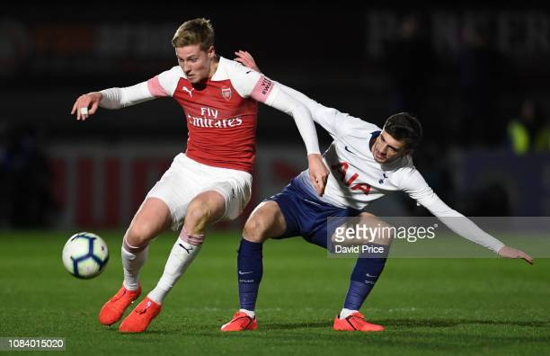 Mark McGuiness of Arsenal is challenged by Troy Parrott of Tottenham during the match between Arsenal U18 and Tottenham Hotspur U18 in the FA Youth...