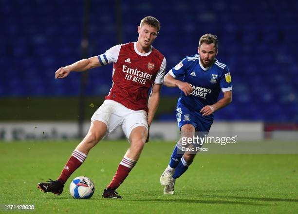 Mark McGuinness of Arsenal passes the ball under pressure from Alan Judge of Ipswich during the Leasingcom Cup match between Ipswich Town and Arsenal...