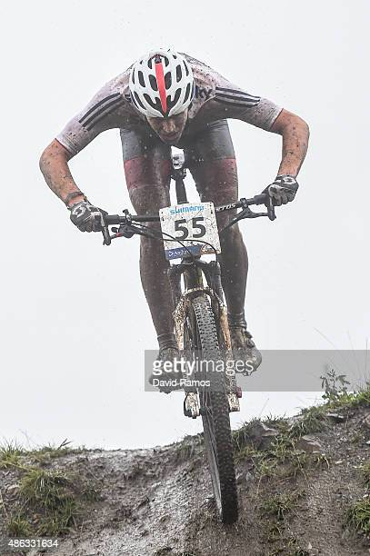 Mark Mcguire of Great Britain competes in the Men Junior CrossCountry Olympic race during day 3 of the UCI Mountain Bike Trials World Championships...