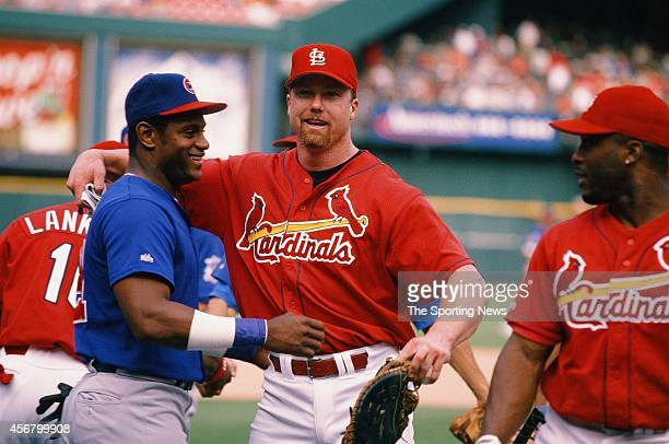 Mark McGuire of the St Louis Cardinalshugs Sammy Sosa the Chicago Cubs at Busch Stadium on August 7 1998 in St Louis Missouri