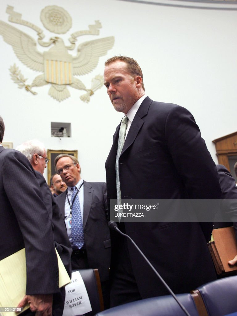 Mark McGwire, former Oakland Athletic and St. Louis Cardinal baseball player, exits the room during a break in testimony before the US House Government Reform Committee during hearings on, 'Restoring Faith in America's Pastime: Evualuating Major League Baseball's Efforts to Eradicate Steroid Use' 17 March 2005 in the Rayburn House Office Building on Capitol Hill. The committee is looking into the use of steroids by Major League Baseball players. AFP Photo/Luke FRAZZA
