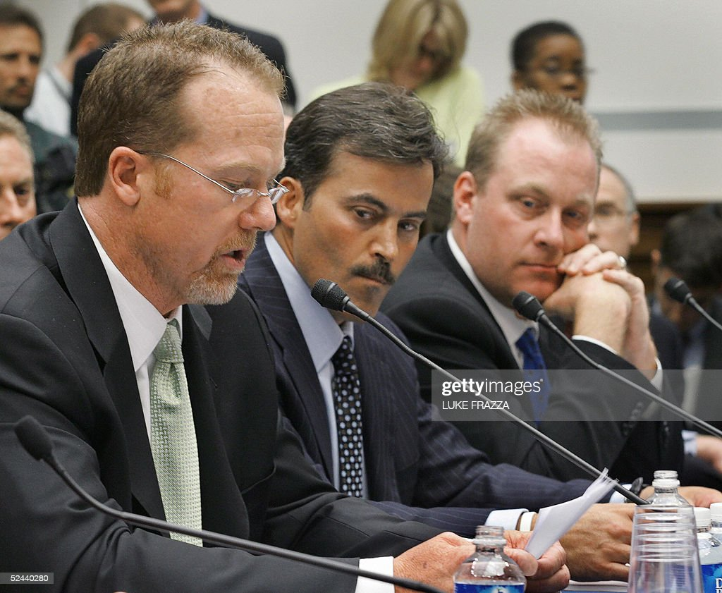 Mark McGwire, former Oakland Athletics and St. Louis Cardinal, testifies as Rafael Palmeiro, current Baltimore Oriole and former Texas Ranger; and Curt Schilling (R), current Boston Red Sox, look on before the US House of Representatives Committee on Government Reform, 'Restoring Faith in America's Pastime: Evualuating Major League Baseball's Efforts to Eradicate Steroid Use' 17 March, 2005, on Capitol Hill. US lawmakers threatened to impose stricter anti-doping measures and revoke Major League Baseball's anti-trust exemption unless the sport's leaders take tougher measures to combat steroids. AFP Photo/Luke FRAZZA