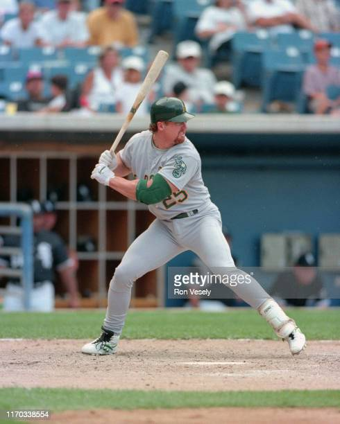 Mark McGwire of the Oakland A's bats during an MLB game at Comiskey Park in Chicago Illinois McGwire played for the A's from 19861997