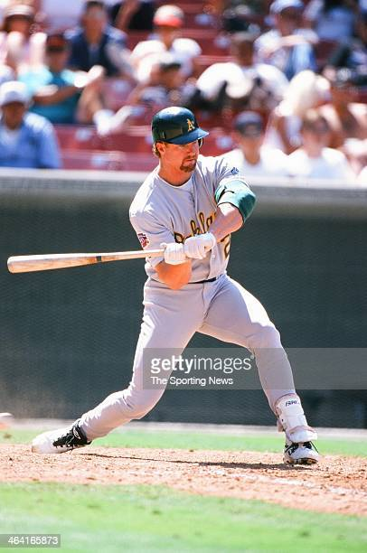 Mark McGwire of the Oakland Athletics bats during the game against the Anaheim Angels on June 22 1997 at Edison Field in Anaheim California