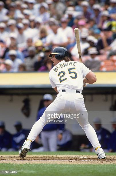 Mark McGwire of the Oakland Athletics bats during the game against the Kansas City Royals at OaklandAlameda County Coliseum on June 18 1995 in...