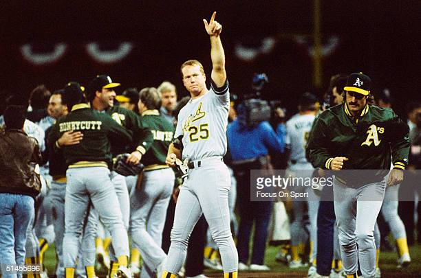 Mark McGwire of the Oakland Athletics gestures to a family member in the stands after winning Game Four of the World Series against the San Francisco...