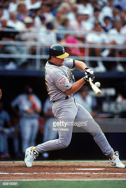 Mark McGwire of the Oakland Athletics makes contact with the pitch during the 1992 AllStar Game at Jack Murphy Stadium on July 14 1992 in San Diego...