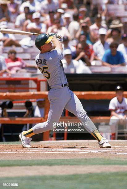 Mark McGwire of the Oakland Athletics swings at the pitch during a season game Mark McGwire played for the Oakland Athletics from 19861997
