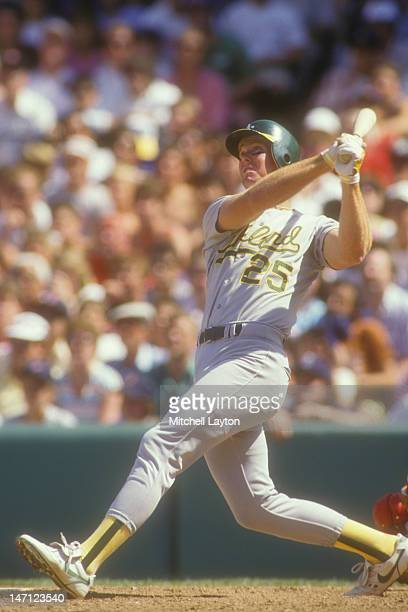 Mark McGwire of the Oakland Athletics takes a swing during a baseball game against the Boston Red Sox on July 19 1987 at Fenway Park in Boston...