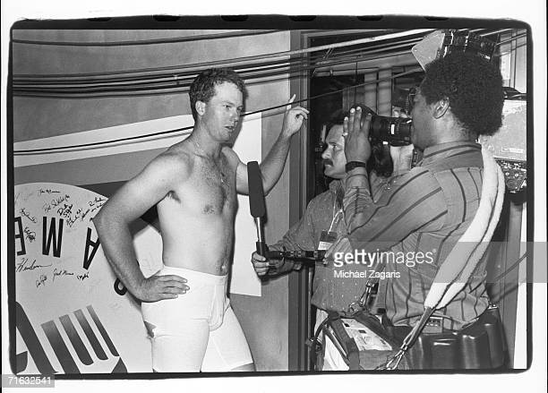 Mark McGwire of the Oakland Athletics talks to reporters in the locker room following the 1987 MLB All Star Game at OaklandAlameda County Coliseum on...
