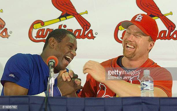 Mark McGwire of the St Louis Cardinals and Sammy Sosa of the Chicago Cubs laugh during a pregame press conference at Busch Stadium 07 September in St...
