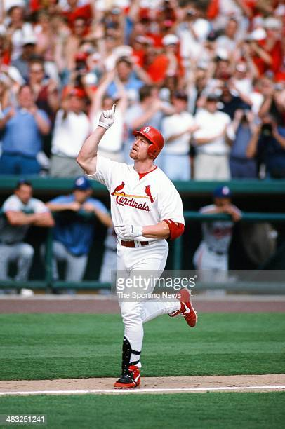 Mark McGwire of the St Louis Cardinals celebrates after hitting a home run against the Montreal Expos on September 27 1998 at Busch Stadium in St...