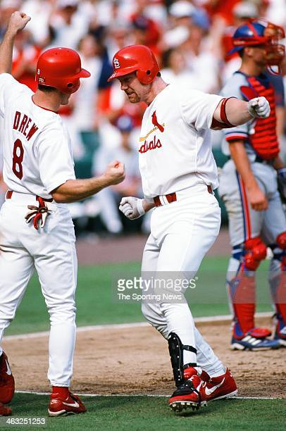 Mark McGwire of the St Louis Cardinals celebrates with teammate JD Drew after hitting a home run against the Montreal Expos on September 27 1998 at...