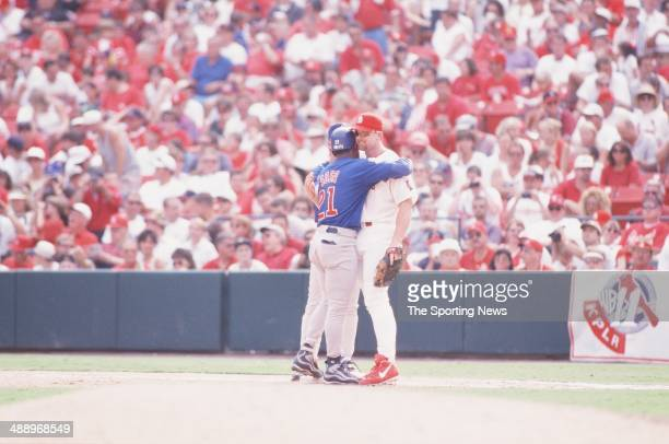 Mark McGwire of the St Louis Cardinals gets a hug from Sammy Sosa of the Chicago Cubs at Busch Stadium on September 7 1998 in St Louis Missouri