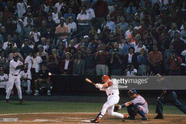 Mark McGwire of the St Louis Cardinals hits a 341 feet line drive over the left field wall for his 62nd home run of the year surpassing the 37year...