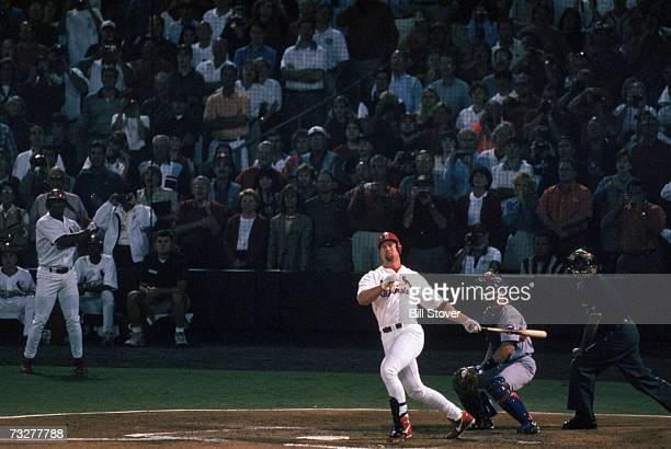 Mark McGwire of the St. Louis Cardinals hits a 341- feet line drive over the left field wall, for his 62nd home run of the year surpassing the...