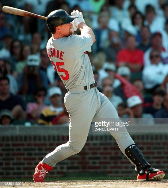 Mark McGwire of the St Louis Cardinals launches his fortyninth home run of the season and a tenth inning gamewinner against the Chicago Cubs 19...