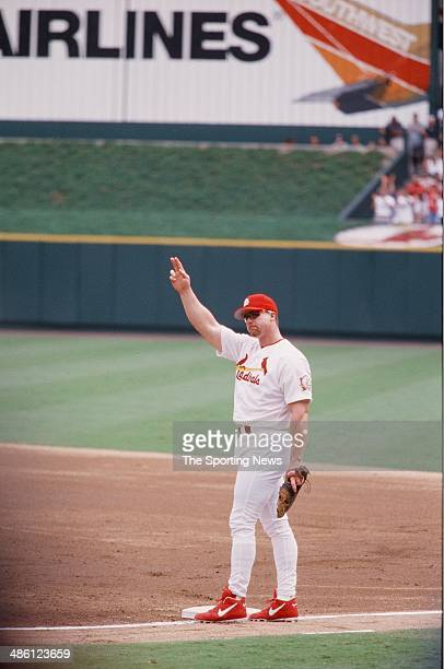 Mark McGwire of the St Louis Cardinals looks on against the Chicago Cubs at Busch Stadium on September 7 1998 in St Louis Missouri