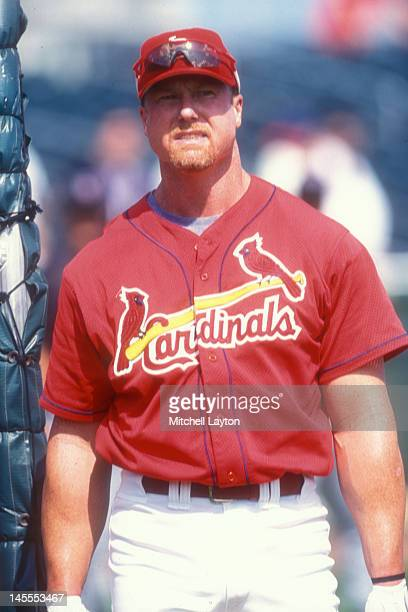 Mark McGwire of the St Louis Cardinals looks on before a baseball game against the Philadelphia Phillies on August 25 1997 at Veterans Stadium in...
