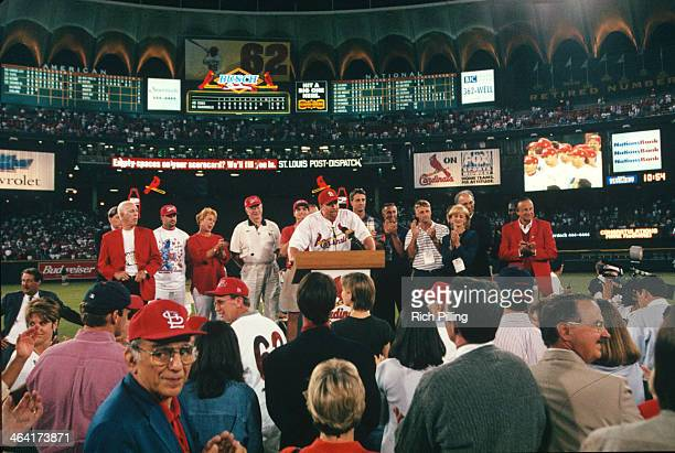 Mark McGwire of the St Louis Cardinals speaks with reporters following a game against the Chicago Cubs where he broke Roger Maris's home run record...