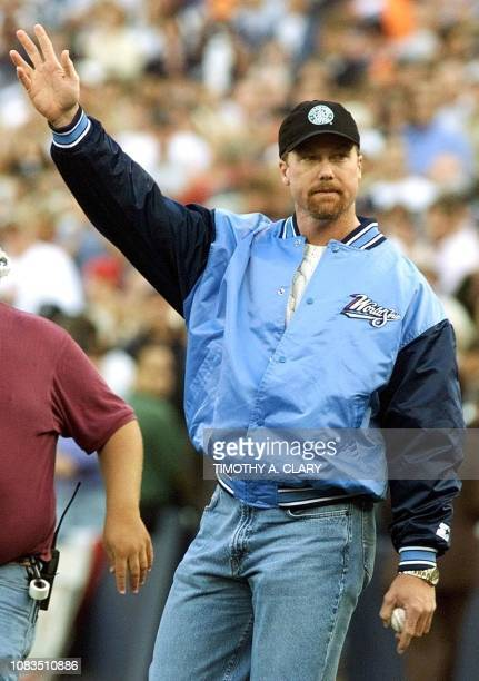 Mark McGwire of the St Louis Cardinals who hit 70 home runs in the regular season waves to fans before throwing out the first pitch prior to game...