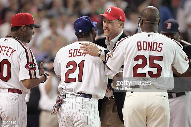 Mark McGwire shakes hands with Sammy Sosa of the National League team as Barry Bonds and Ken Griffey Jr look during a ceremony homoring members of...