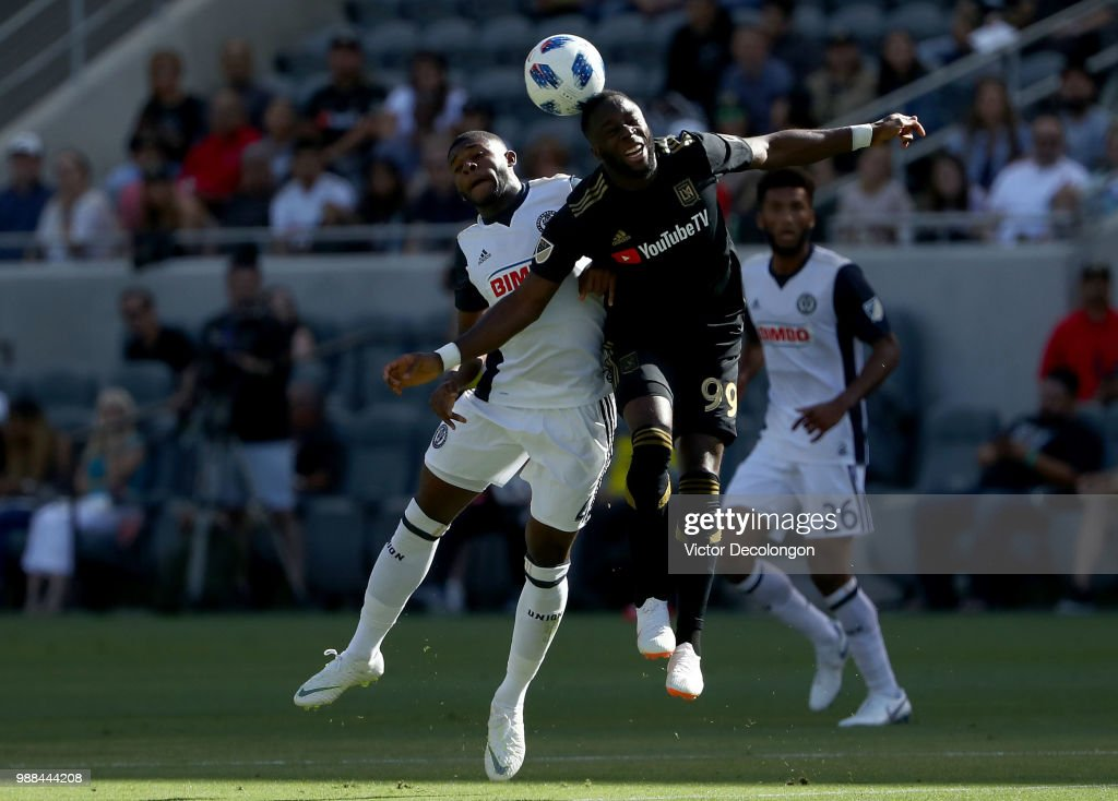 Mark McKenzie #4 of Philadelphia Union and Adama Diomande #99 of Los Angeles FC vie for the ball during the first half of the MLS match at Banc of California Stadium on June 30, 2018 in Los Angeles, California. Los Angeles FC defeated the Philadelphia Union 4-1.