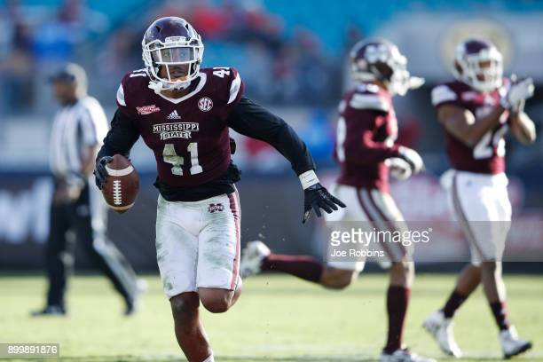 Mark McLaurin of the Mississippi State Bulldogs reacts after his third interception of the game in the fourth quarter of the TaxSlayer Bowl against...