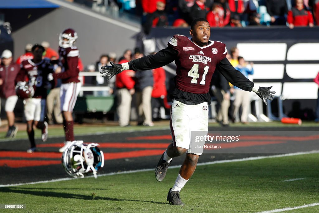 Mark McLaurin #41 of the Mississippi State Bulldogs reacts as time runs out in the fourth quarter of the TaxSlayer Bowl against the Louisville Cardinals at EverBank Field on December 30, 2017 in Jacksonville, Florida. The Bulldogs won 31-27.