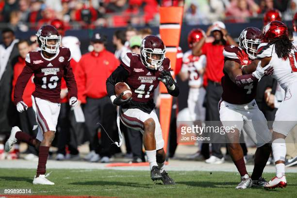 Mark McLaurin of the Mississippi State Bulldogs returns the second of his three interceptions in the game in the fourth quarter of the TaxSlayer Bowl...