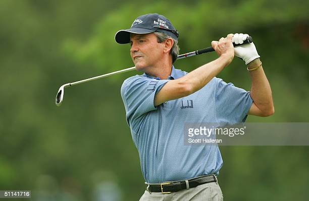 Mark McNulty hits a shot during the first round of the 25th US Senior Open at Bellerive Country Club on July 29 2004 in St Louis Missouri