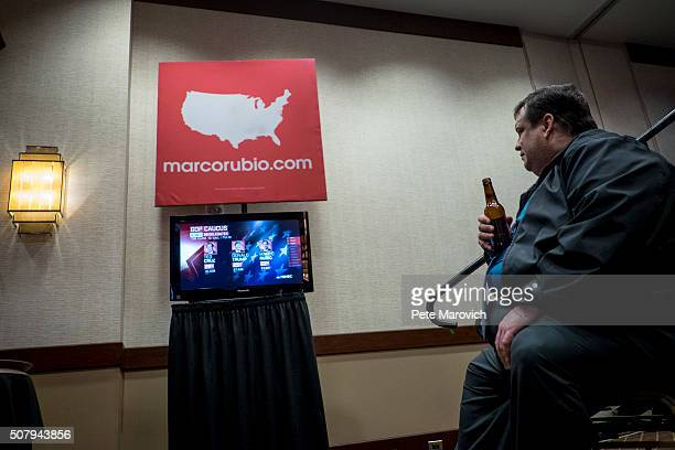Mark McPhilimy of Columbus Ohio watches returns come in as supporters await the arrival of Republican Presidential Candidate Senator Marco Rubio at a...