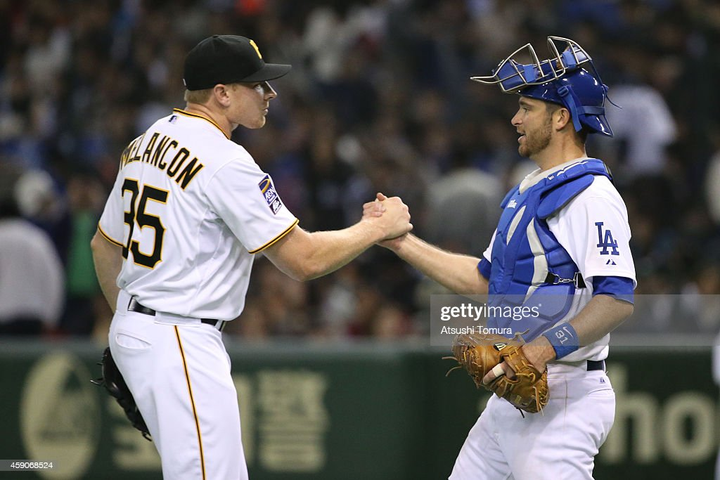 Mark Melancon (L) #35 of the Pittsburgh Pirates and Drew Butera (R) #31 of the Los Angeles Dodgers celebrate after winning during the game four of Samurai Japan and MLB All Stars at Tokyo Dome on November 16, 2014 in Tokyo, Japan.