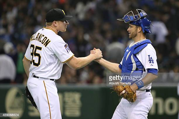 Mark Melancon of the Pittsburgh Pirates and Drew Butera of the Los Angeles Dodgers celebrate after winning during the game four of Samurai Japan and...