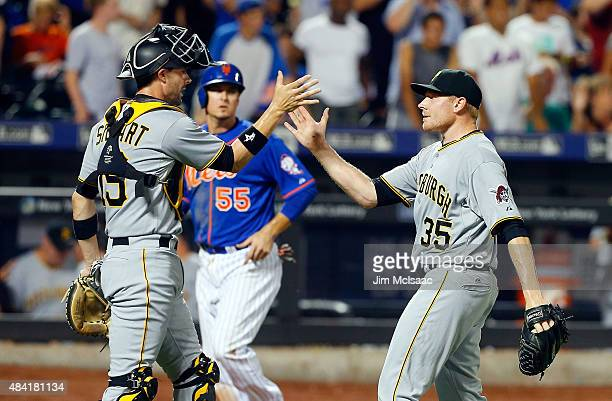 Mark Melancon and Chris Stewart of the Pittsburgh Pirates celebrate after defeating the New York Mets at Citi Field on August 15 2015 in the Flushing...