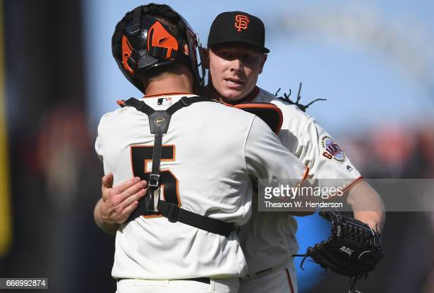 Mark Melancon and Nick Hundley of the San Francisco Giants celebrate deteating the Arizona Diamondbacks 41 on opening day at ATT Park on April 10...