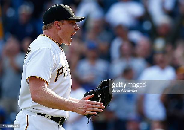Mark Melancon of the Pittsburgh Pirates reacts after closing out the 9th inning against the Chicago Cubs during game one of the doubleheader at PNC...