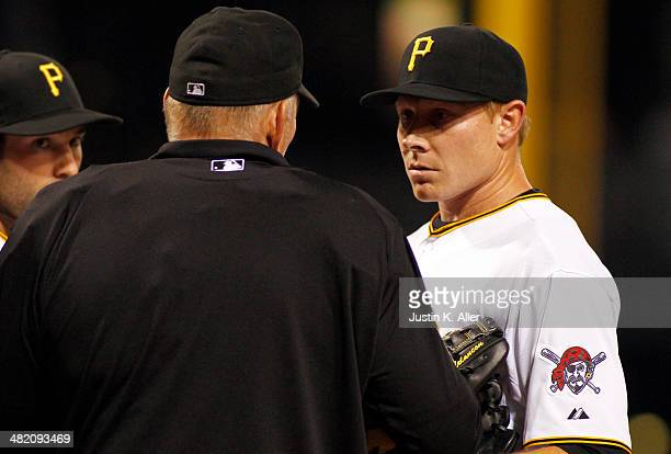 Mark Melancon of the Pittsburgh Pirates talks with home plate umpire Bob Davidson in the eighth inning against the Chicago Cubs during the game at...