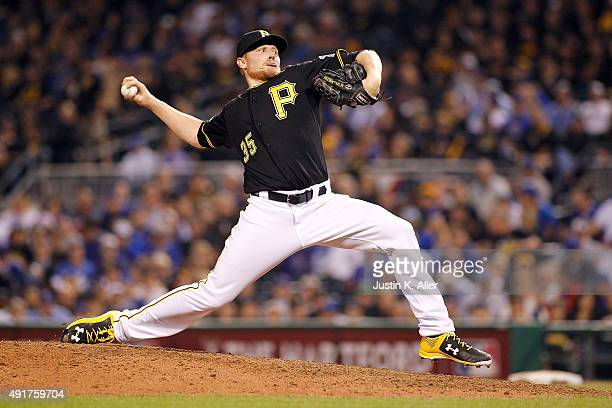 Mark Melancon of the Pittsburgh Pirates throws a pitch in the ninth inning against the Chicago Cubs during the National League Wild Card game at PNC...